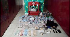 Droga, dinero, armas y otros objetos incautados por las autoridades. /SN